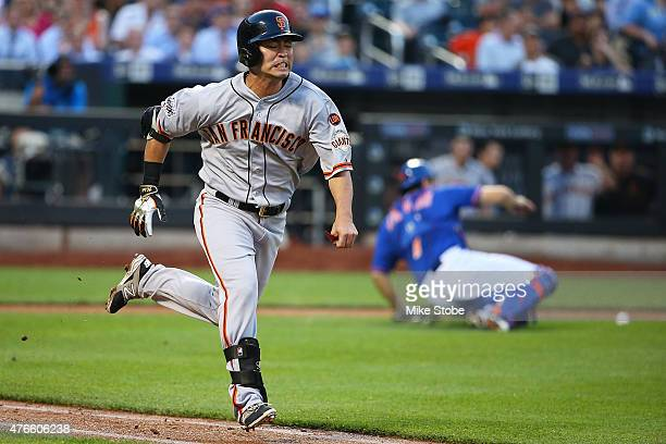 Nori Aoki of the San Francisco Giants runs out an infield single in the second inning against the New York Mets at Citi Field on June 10, 2015 in...