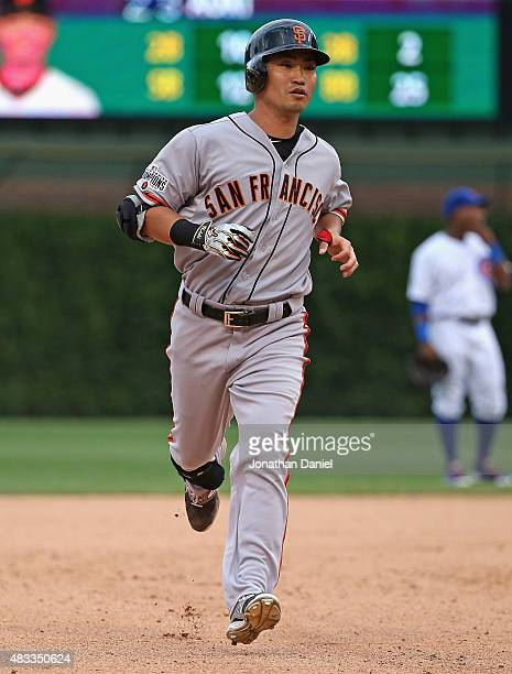 Nori Aoki of the San Francisco Giants runs the bases after hitting a solo home run in the 8th inning against the Chicago Cubs at Wrigley Field on...