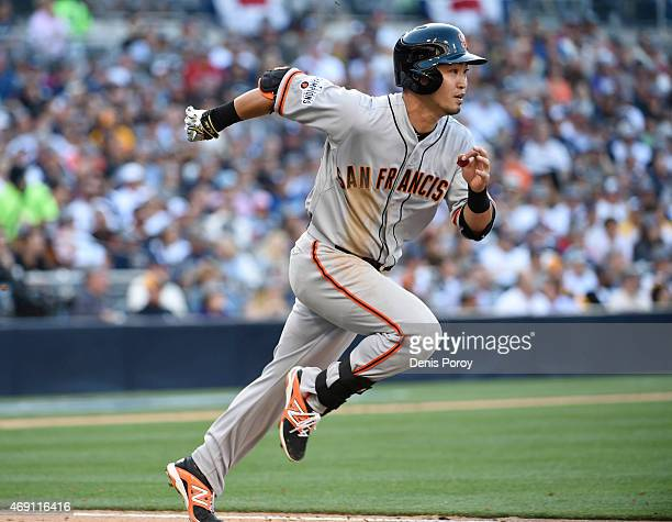 Nori Aoki of the San Francisco Giants runs to first after grounding out during the sixthinning of the home opener against the San Diego Padres in the...