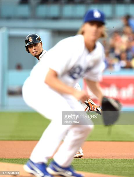 Nori Aoki of the San Francisco Giants runs to second base behind Zack Greinke of the Los Angeles Dodgers during the first inning at Dodger Stadium on...