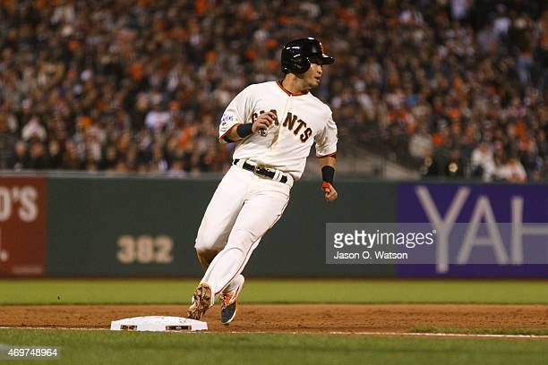 Nori Aoki of the San Francisco Giants runs to third base against the Colorado Rockies during the fifth inning at ATT Park on April 14 2015 in San...