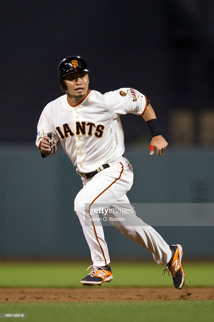 Nori Aoki #23 of the San Francisco Giants runs to third base against the Colorado Rockies during the third inning at AT&T Park on April 14, 2015 in San Francisco, California.