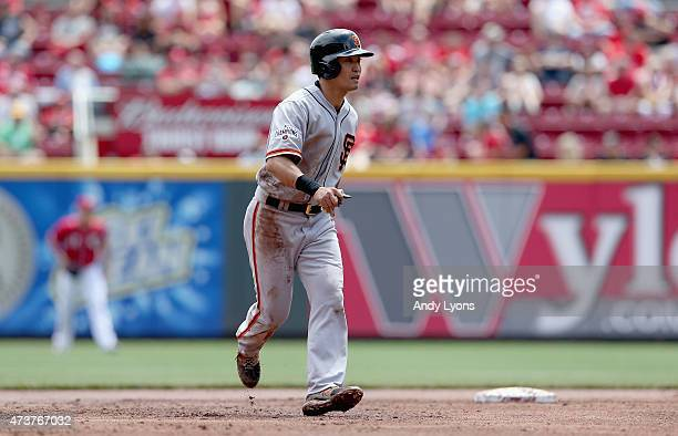 Nori Aoki of the San Francisco Giants runs to third base in the second inning against the Cincinnati Reds for a stolen base at Great American Ball...