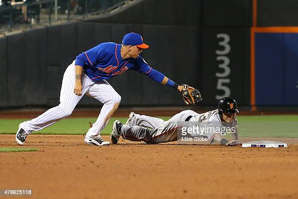 Nori Aoki of the San Francisco Giants slides into second safely in front of the tag of Wilmer Flores of the New York Mets in the ninth inning at Citi...