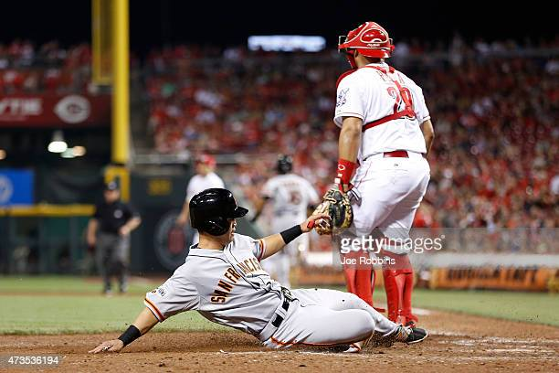 Nori Aoki of the San Francisco Giants slides safely at home plate to score a run in the eighth inning of the game against the Cincinnati Reds at...