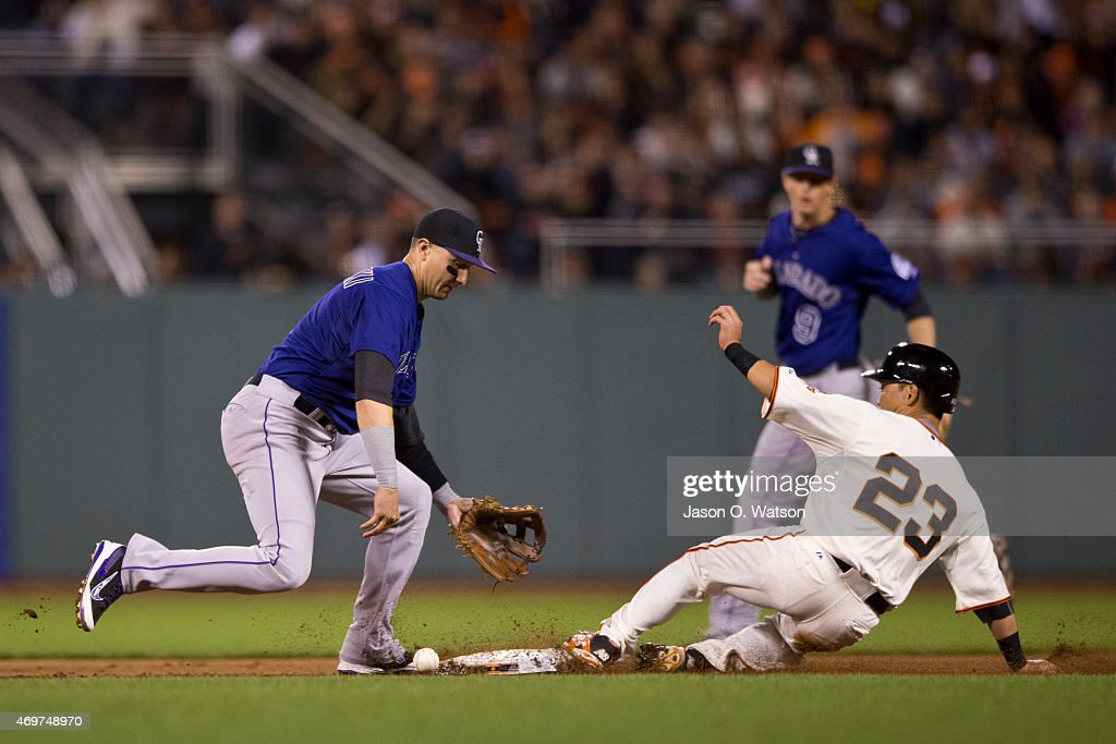 Nori Aoki #23 of the San Francisco Giants steals second base ahead of a throw to Troy Tulowitzki #2 of the Colorado Rockies during the fifth inning at AT&T Park on April 14, 2015 in San Francisco, California.