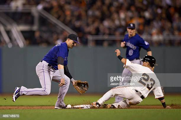 Nori Aoki of the San Francisco Giants steals second base ahead of a throw to Troy Tulowitzki of the Colorado Rockies during the fifth inning at ATT...
