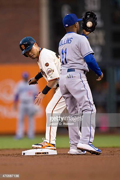 Nori Aoki of the San Francisco Giants steals second base ahead of a tag from Jimmy Rollins of the Los Angeles Dodgers during the first inning at ATT...