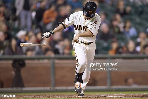 Nori Aoki of the San Francisco Giants throws his bat away in frustation after he flies out to left field against the Chicago Cubs in the bottom of...