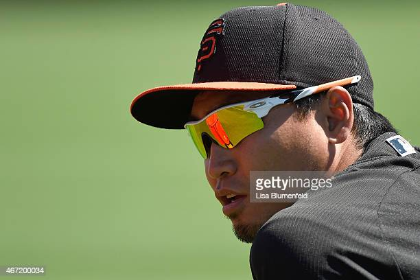 Nori Aoki of the San Francisco Giants warms up before the game agaainst the Los Angeles Angels of Anaheimduring a spring training game at Tempe...