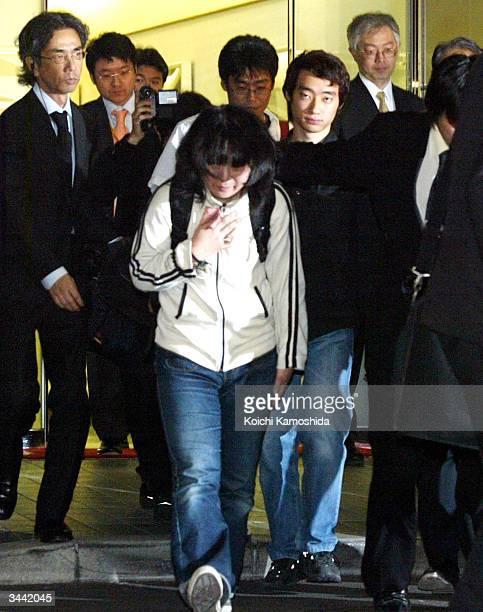 Noriaki Imai Soichiro Koriyama with a white shirt and glasses and Nahoko Takato arrive at Tokyo International Airport April 18 2004 in Tokyo Japan...