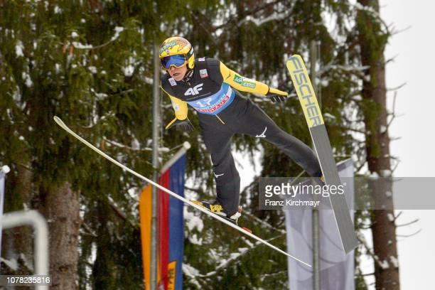Noriaki Kasai of Japan competes during the 67th FIS Nordic World Cup Four Hills Tournament ski jumping event at PaulAußerleitnerSchanze on January 6...