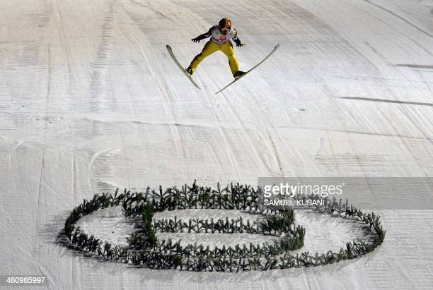 Noriaki Kasai of Japan competes during the Four Hills competition of the FIS Ski Jumping World cup in Bischofshofen on January 6, 2014. AFP...