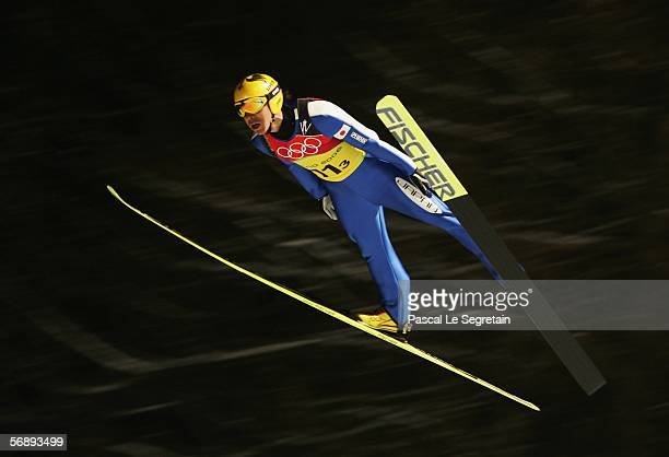 Noriaki Kasai of Japan competes in the Team Event of the Large Hill Ski Jumping competition on Day 10 of the 2006 Turin Winter Olympic Games on...