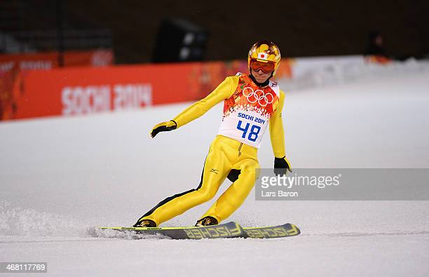 Noriaki Kasai of Japan reacts after landing his jump in his Men's Normal Hill Individual Final on day 2 of the Sochi 2014 Winter Olympics at the...