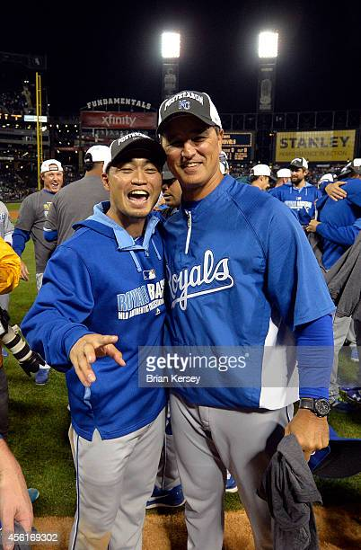 Norichika Aoki and bench coach Don Wakamatsu of the Kansas City Royals celebrate after defeating the Chicago White Sox to clinch a Wild Card berth at...