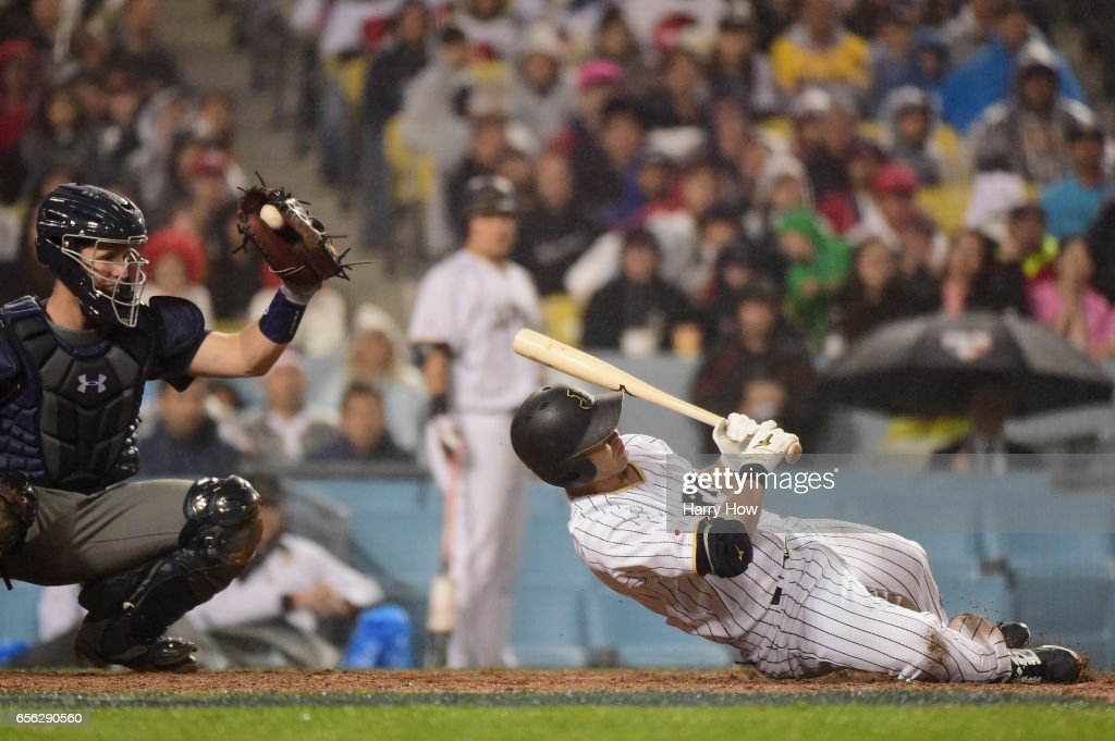 Norichika Aoki #7 of team Japan dives away from an inside pitch in the eighth inning against team United States during Game 2 of the Championship Round of the 2017 World Baseball Classic at Dodger Stadium on March 21, 2017 in Los Angeles, California.