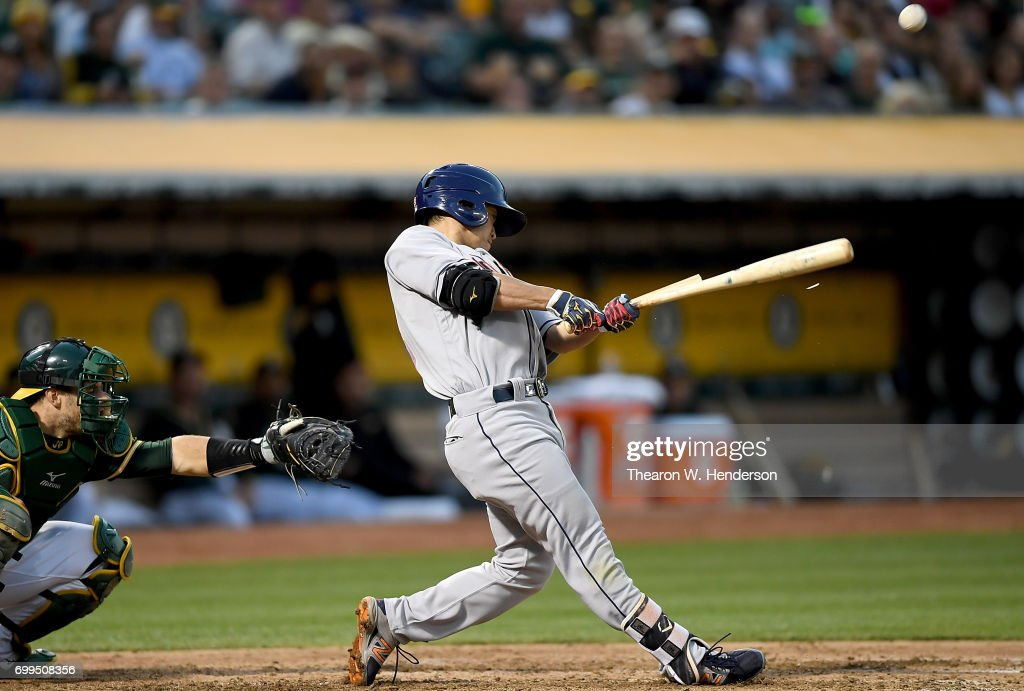 Norichika Aoki #3 of the Houston Astros breaks his bat while popping out to third baseman Ryon Healy #25 of the Oakland Athletics in the top of the fifth inning at Oakland Alameda Coliseum on June 21, 2017 in Oakland, California.