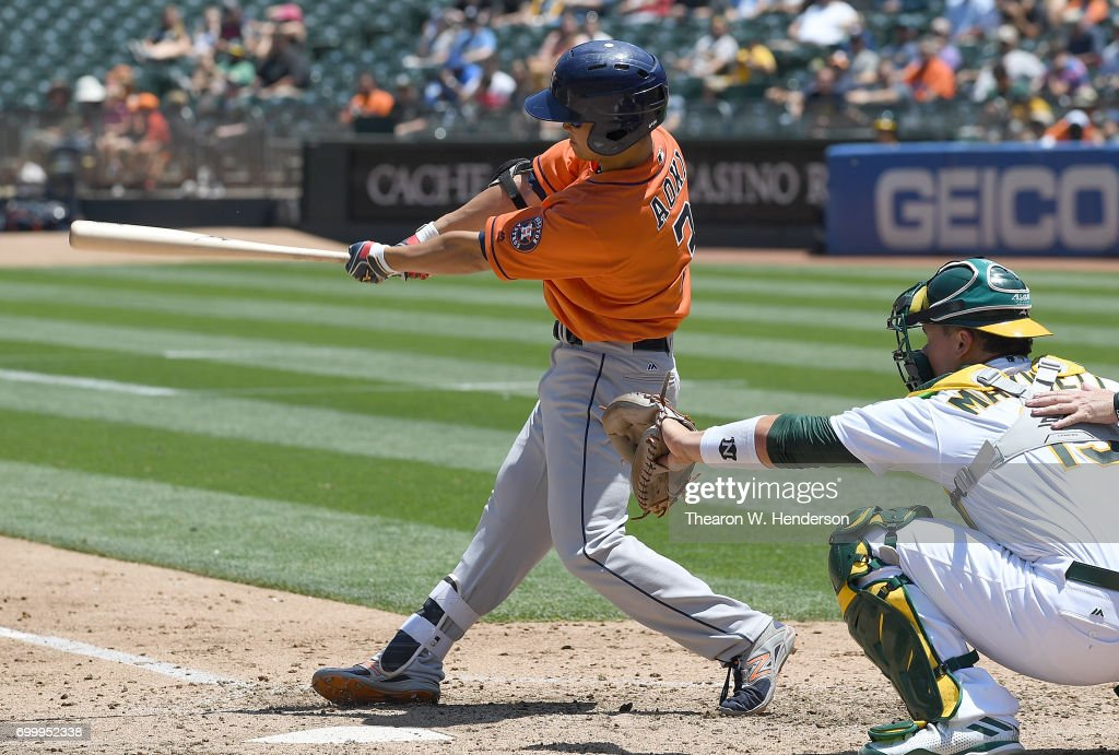 Norichika Aoki #3 of the Houston Astros hits a single against the Oakland Athletics in the top of the third inning at Oakland Alameda Coliseum on June 22, 2017 in Oakland, California.