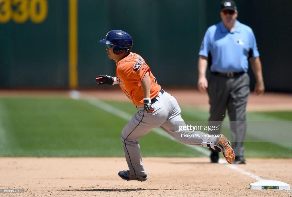 Norichika Aoki #3 of the Houston Astros rounds first base on his way to second with a double against the Oakland Athletics in the top of the fifth inning at Oakland Alameda Coliseum on June 22, 2017 in Oakland, California.