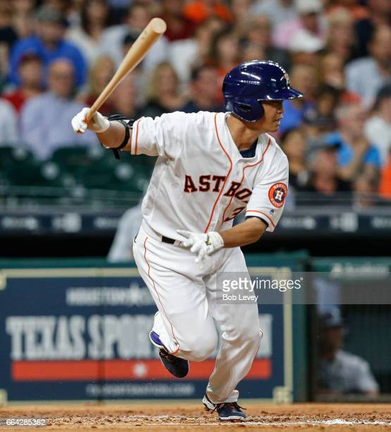 Norichika Aoki of the Houston Astros singles in the third inning against the Seattle Mariners at Minute Maid Park on April 3, 2017 in Houston, Texas.