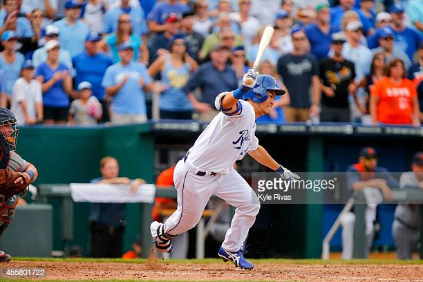 Norichika Aoki of the Kansas City Royals advances the runners but grounds out against the Detroit Tigers defense in the ninth inning on September 20...