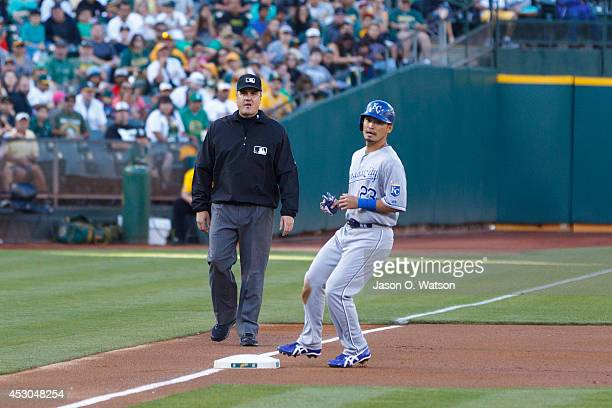Norichika Aoki of the Kansas City Royals advances to third base on a wild pitch against the Oakland Athletics during the first inning at Oco Coliseum...