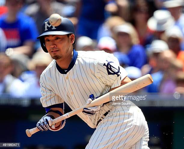 Norichika Aoki of the Kansas City Royals bunts his way onto first base during the 1st inning of the game against the Baltimore Orioles at Kauffman...