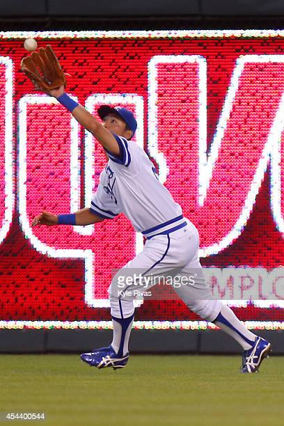 Norichika Aoki of the Kansas City Royals catches a Cleveland Indians outfield hit in the fifth inning on August 2014 at Kauffman Stadium in Kansas...