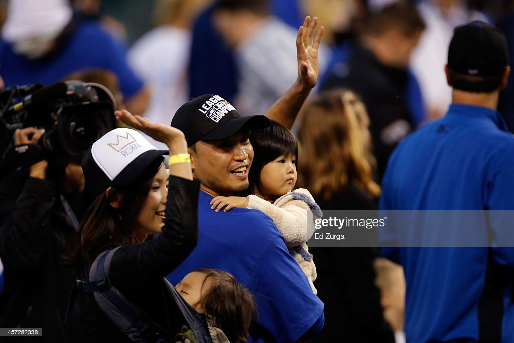 Norichika Aoki #23 of the Kansas City Royals celebrates with his wife, Sachi and their two kids after their 2 to 1 win over the Baltimore Orioles to sweep the series in Game Four of the American League Championship Series at Kauffman Stadium on October 15, 2014 in Kansas City, Missouri.