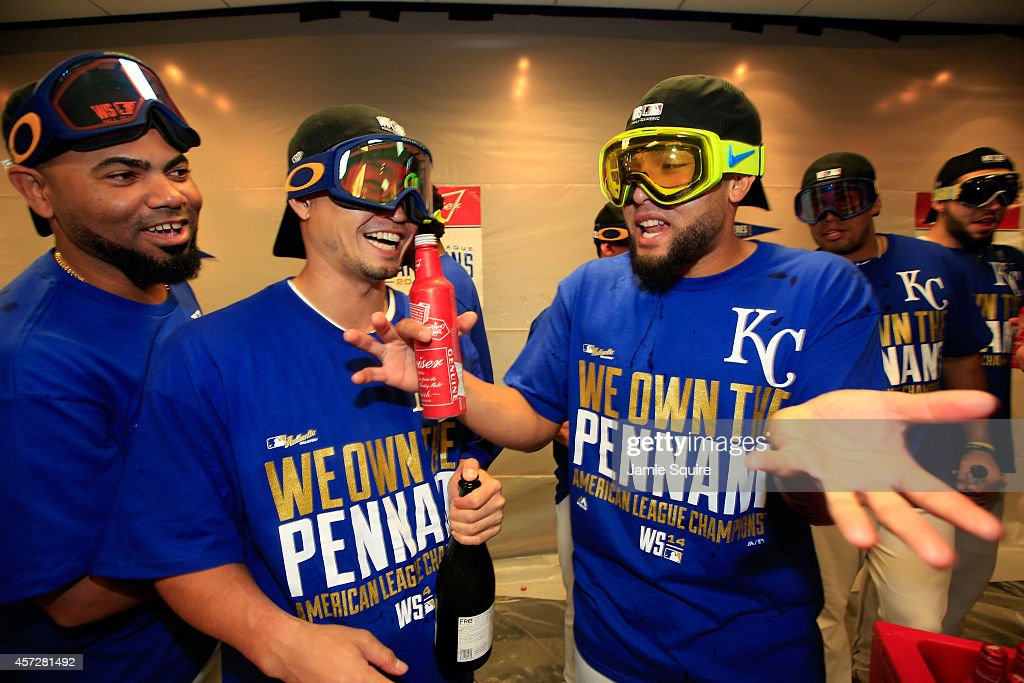 Norichika Aoki #23 of the Kansas City Royals celebrates with teammates Kelvin Herrera and #40 Francisley Bueno #67 in the locker room after their 2 to 1 win over the Baltimore Orioles to sweep the series in Game Four of the American League Championship Series at Kauffman Stadium on October 15, 2014 in Kansas City, Missouri.