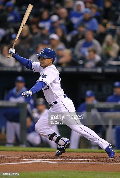 Norichika Aoki of the Kansas City Royals follows through on his swing as he grounds out in the first inning during a game against the Boston Red Sox...