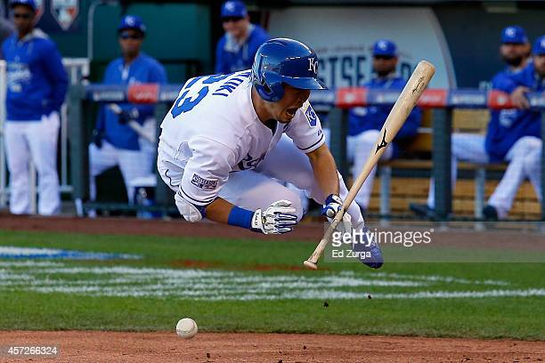 Norichika Aoki of the Kansas City Royals gets hit from a pitch by Miguel Gonzalez of the Baltimore Orioles in the first inning during Game Four of...