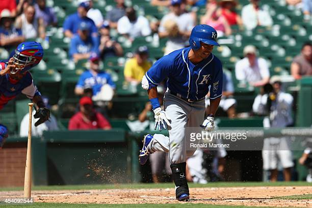 Norichika Aoki of the Kansas City Royals grounds out against the Texas Rangers in the fifth inning at Globe Life Park in Arlington on August 24 2014...