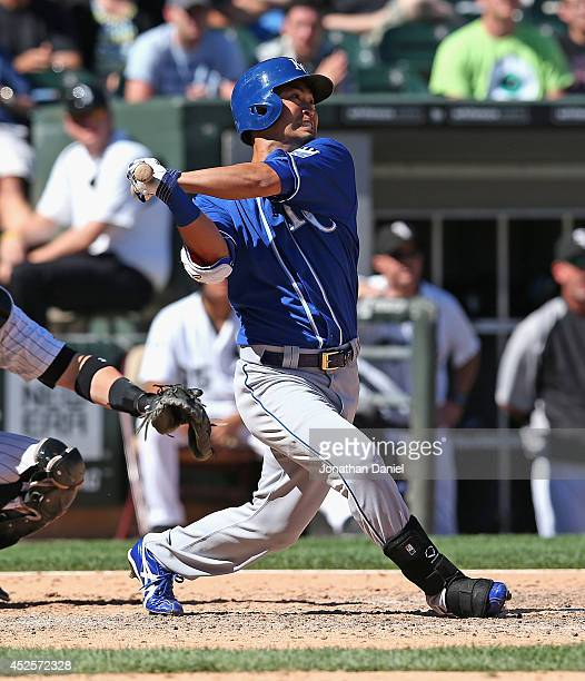 Norichika Aoki of the Kansas City Royals hits a single in the top of the 9th inning against the Chicago White Sox at US Cellular Field on July 23...