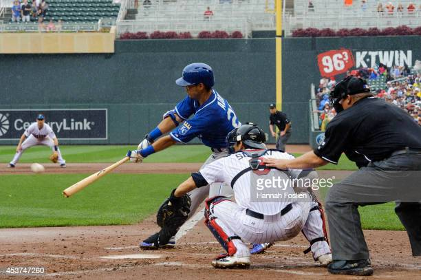 Norichika Aoki of the Kansas City Royals hits a two-run single against the Minnesota Twins during the second inning of the game on August 17, 2014 at...