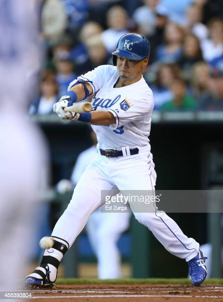 Norichika Aoki of the Kansas City Royals hits an RBI single in the first inning against the Boston Red Sox at Kauffman Stadium on September 13, 2014...