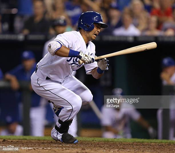 Norichika Aoki of the Kansas City Royals jumps out of the way of a ball as he bats in the in the ninth inning against the Seattle Mariners at...