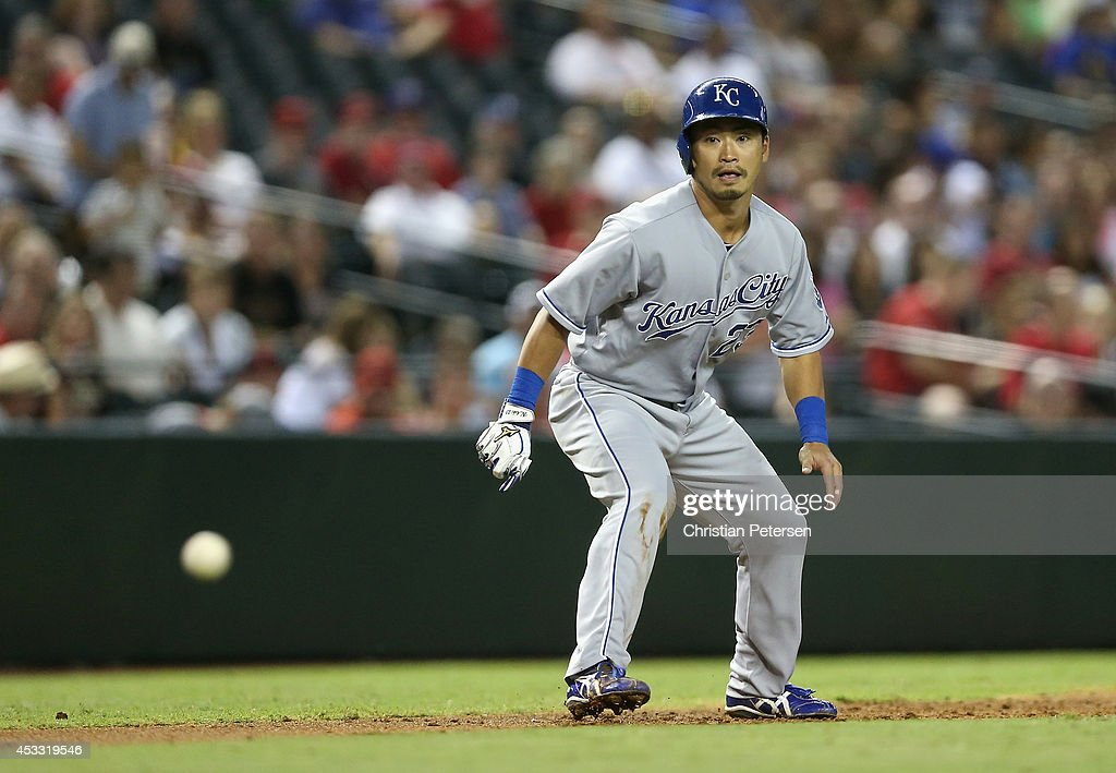 Norichika Aoki #23 of the Kansas City Royals leads off of third base as the ball is hit in play during the MLB game against the Arizona Diamondbacks at Chase Field on August 7, 2014 in Phoenix, Arizona.