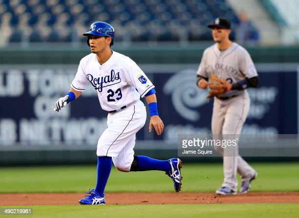 Norichika Aoki of the Kansas City Royals leads off second base as Troy Tulowitzki of the Colorado Rockies watches the pitch during the 1st inning of...