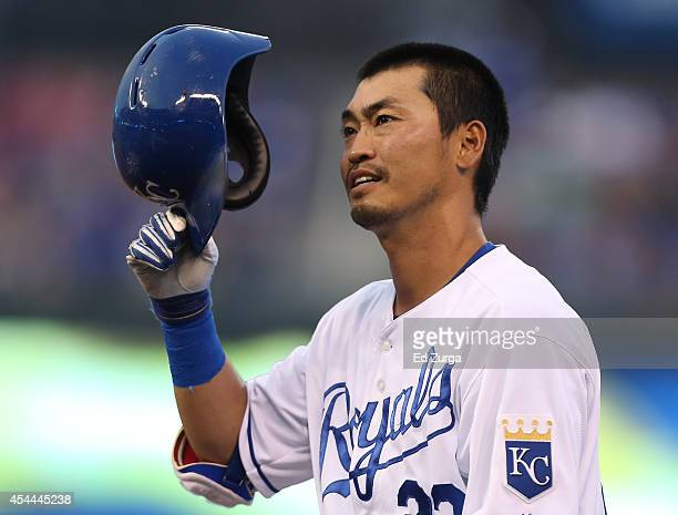 Norichika Aoki of the Kansas City Royals puts his helmet back on as he heads back to first after hitting a single in the first inning against the...
