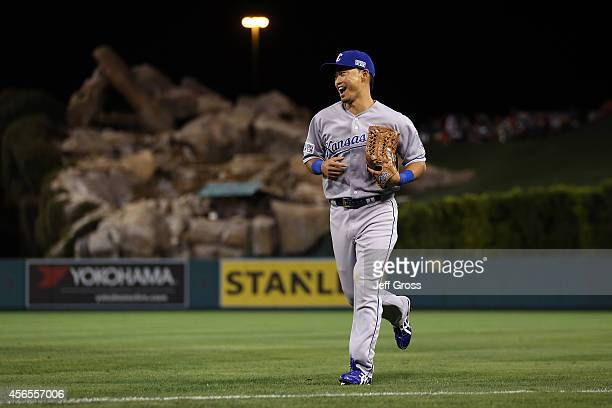 Norichika Aoki of the Kansas City Royals reacts after making a catch in the sixth inning against the Los Angeles Angels during Game One of the...