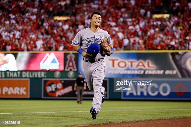Norichika Aoki of the Kansas City Royals reacts after making a catch in the seventh inning against the Los Angeles Angels during Game One of the...
