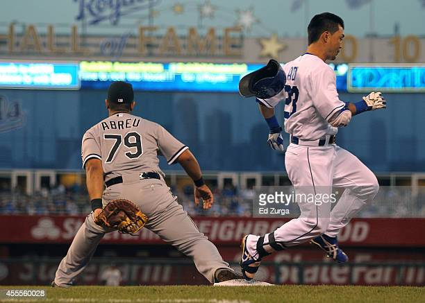 Norichika Aoki of the Kansas City Royals runs across first base past Jose Abreu of the Chicago White Sox as he grounds out in the first inning at...