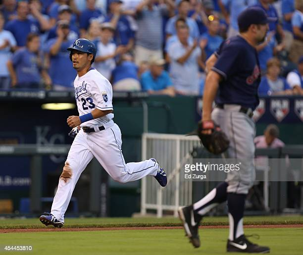 Norichika Aoki of the Kansas City Royals runs home to score on an Alex Gordon sacrifice fly in the first inning during a game against the Cleveland...