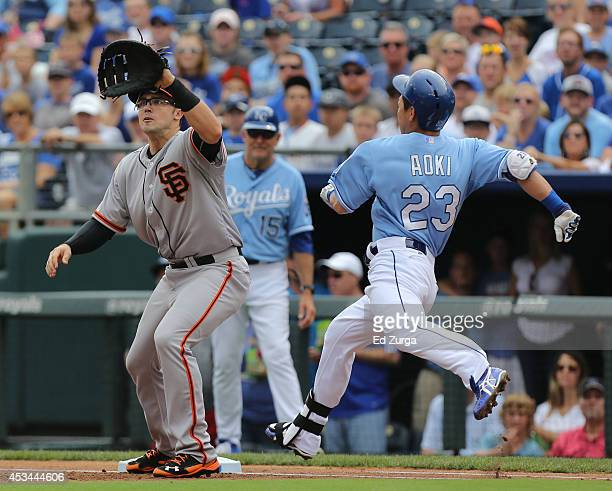 Norichika Aoki of the Kansas City Royals runs to first as he beats the throw to Adam Duvall of the San Francisco Giants for a single in the first...
