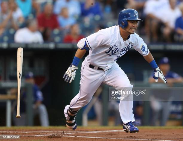 Norichika Aoki of the Kansas City Royals runs to first as he grounds out in the first inning against the Texas Rangers at Kauffman Stadium on...