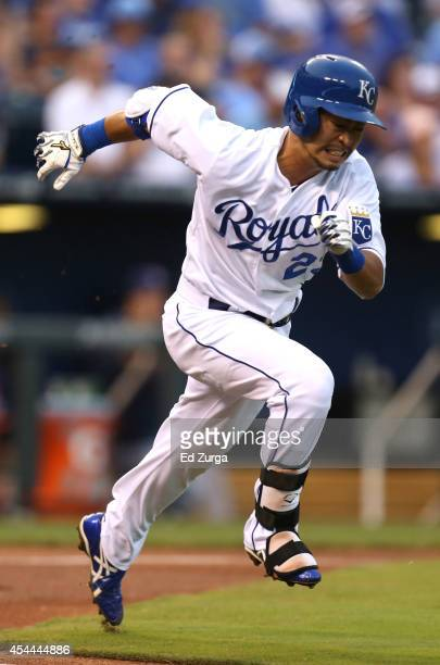 Norichika Aoki of the Kansas City Royals runs to first as he hits a single in the first inning against the Cleveland Indians on August 31 2014 at...