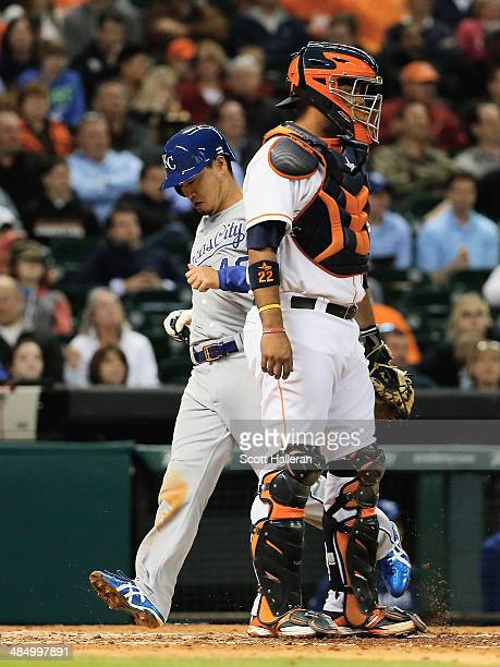 Norichika Aoki of the Kansas City Royals scores a run in the fifth inning against the Houston Astros as Carlos Corporan looks on at Minute Maid Park...
