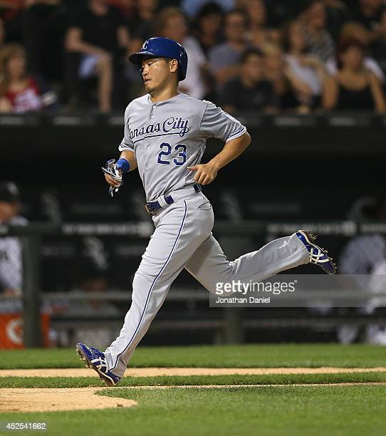 Norichika Aoki of the Kansas City Royals scores a run on a sacrifice fly by teammate Omar Infante in the 6th inning against the Chicago White Sox US...